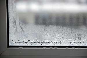 Condensation in between window glass panes