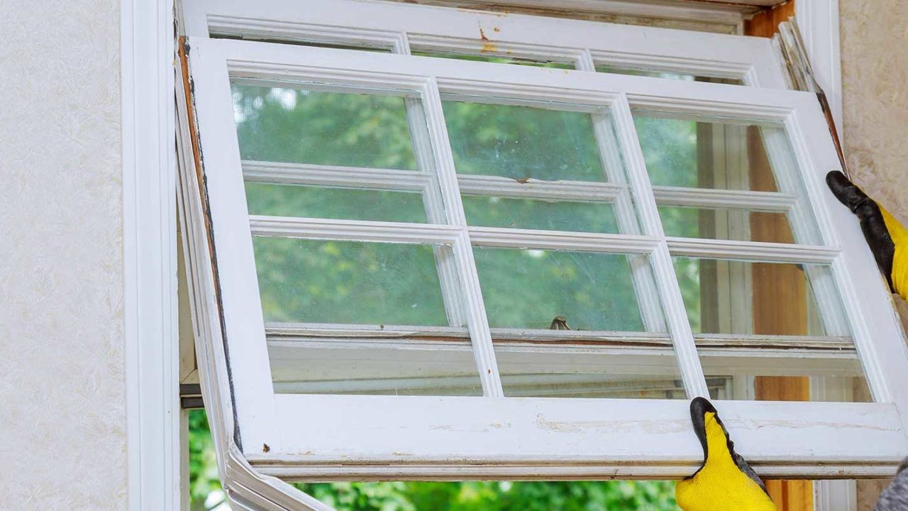 Residential window replacement contractor replacing old windows