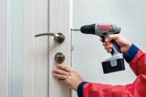 man doing a residential door installation