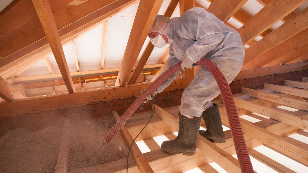 Professional insulation contractor installing insulation