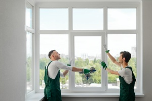 two men Replace Old Windows