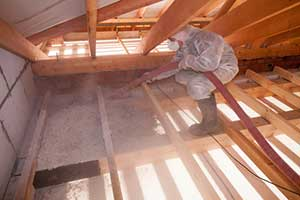 Blown in insulation being installed in attic