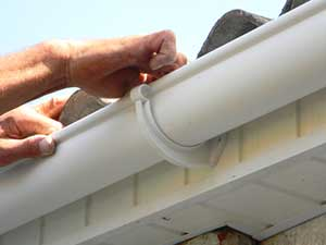 Gutter replacement contractor replacing old gutters