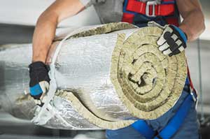Insulation contractor carrying commercial insulation
