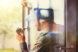Man replacing old and outdated windows