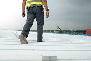 Northern VA commercial roofing contractor inspecting roof