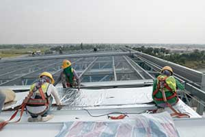 Roofers installing a new commercial roof