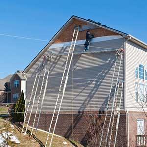 Siding contractors performing siding installation services