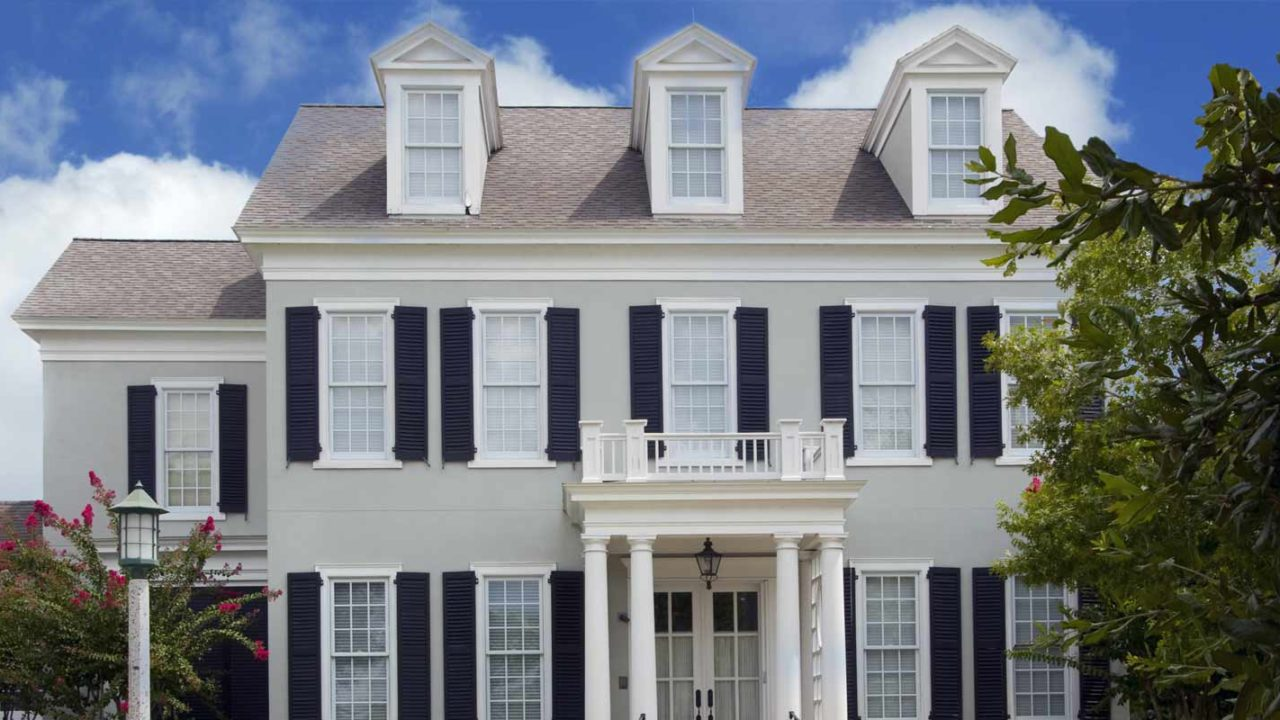 Colonial home with new siding installed