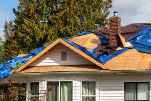 roof tiles are removed before the replacement begins