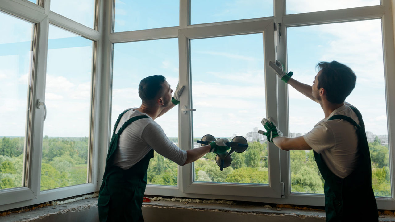 two workers on windows after client knows how often do windows need to be replaced