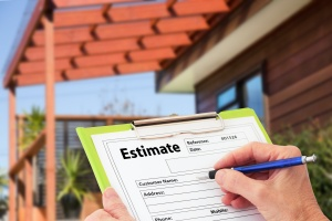 Hand Writing an Estimate from a Roofing Contractor with workmanship warranty