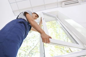 one man working on windows after knowing how often do windows need to be replaced