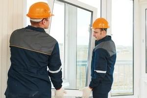 Workers in Orange Helmet Installing Windows