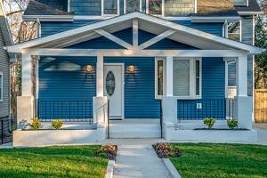 blue horizontal vinyl lap siding single family home