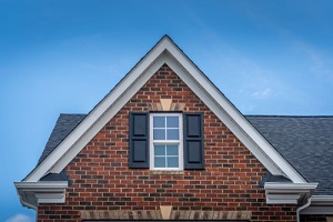 red brick facade siding with double hung window