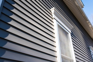vinyl siding and new windows on residential home