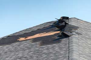 Damaged roof in need of a roof replacement
