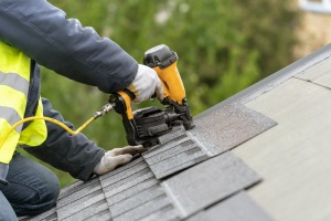 men working on a roof remodeling