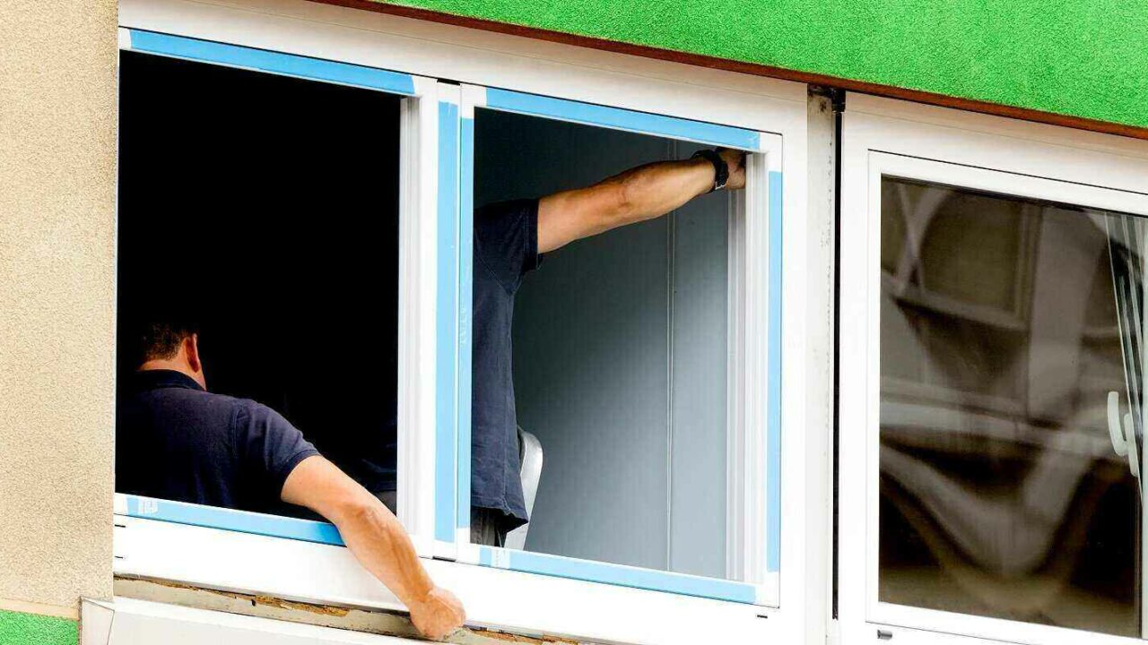 construction workers replacing and installing windows