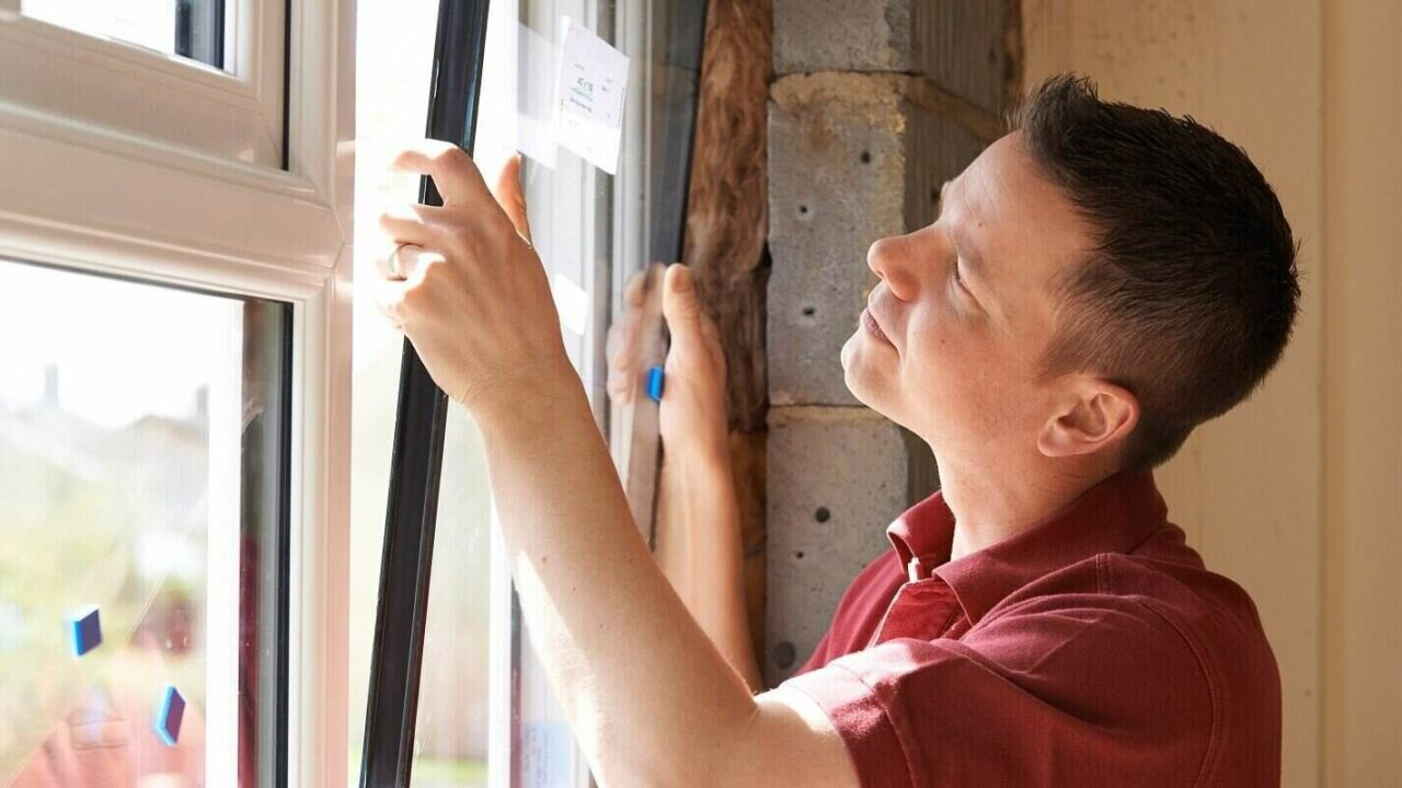 homeowner Installing new windows in house