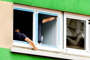 construction workers replacing and installing window