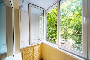 open window with a view of the forest