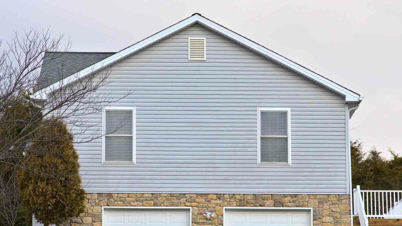 side view of a house blue vinyl siding