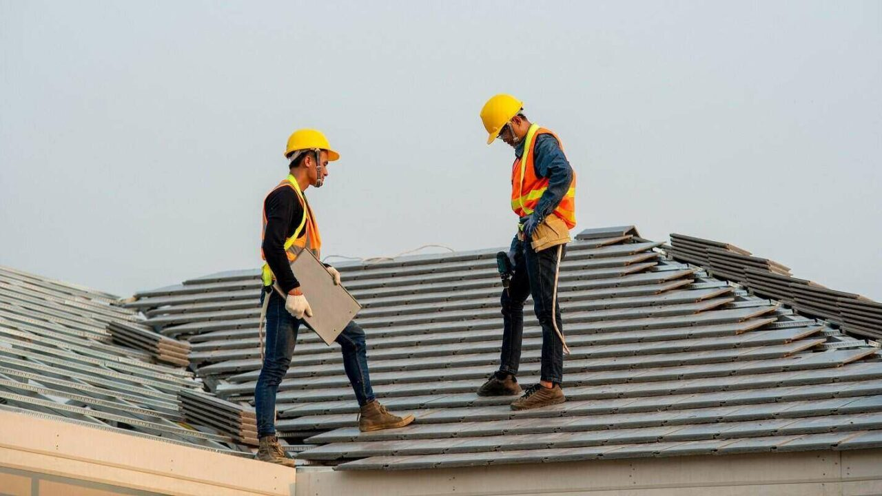 construction worker wearing safety harness belt during working on roof structure
