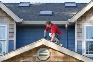 man doing roofing work on the top