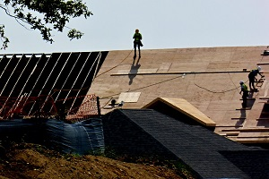 workers installing new roof