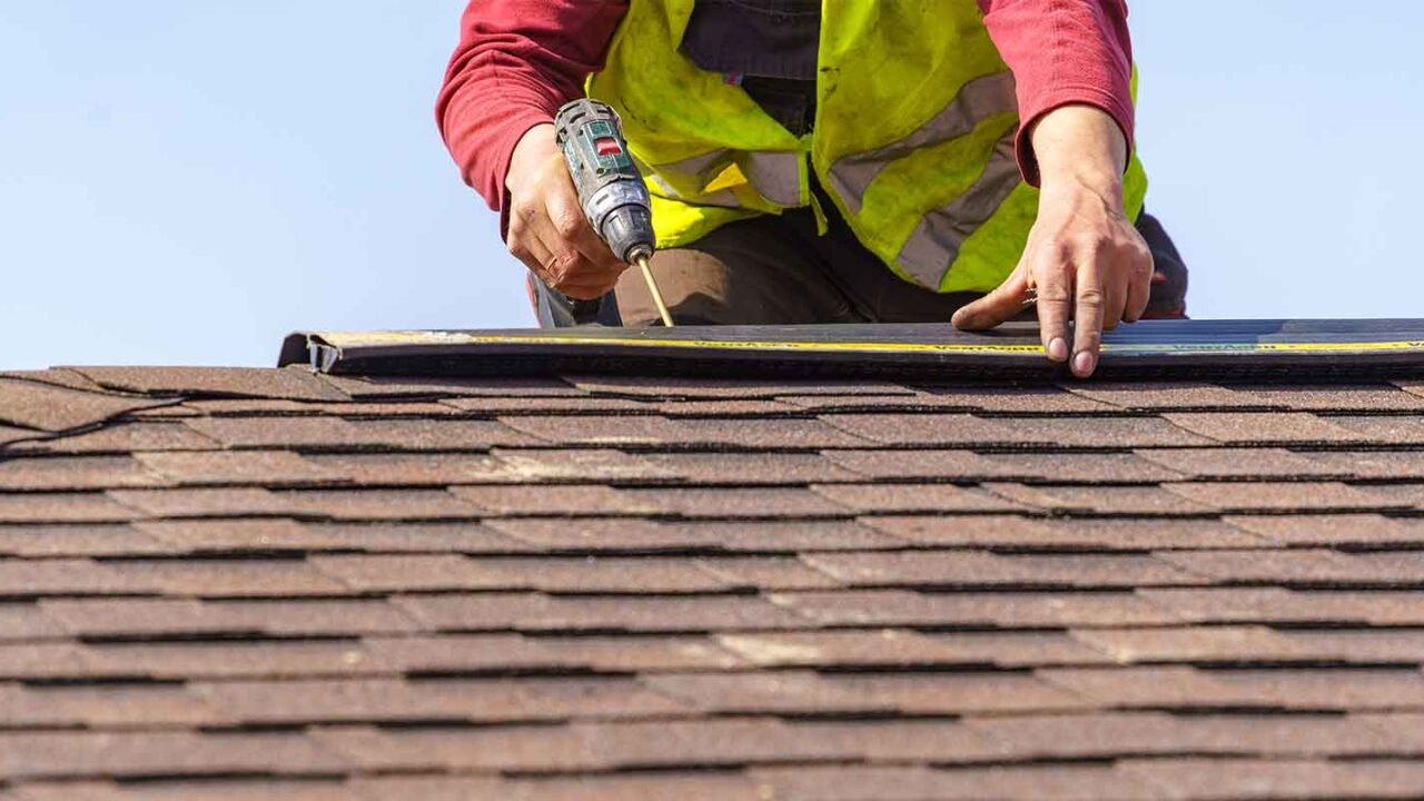 roofing professional replacing a roof in a home