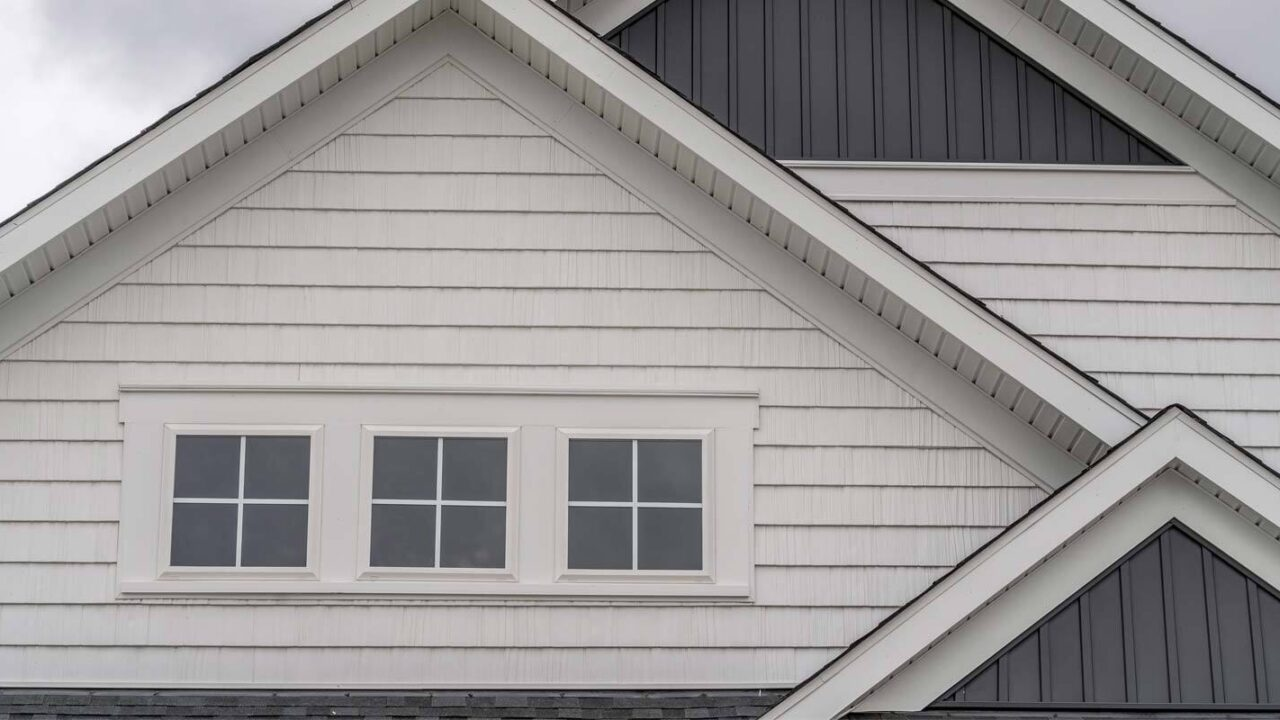 the front of a home that has mold underneath its siding
